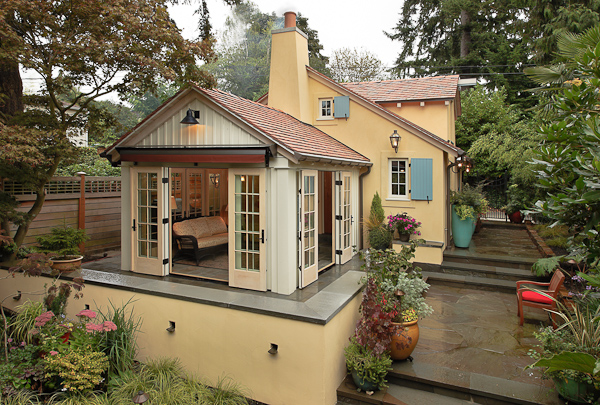 Nice Sunroom Has French Doors On Three Sides That Open To A Raised Terrace.